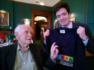 Frank Rushbrook with Rory Hadden holding a BRE Centre t-shirt